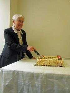 Tess' 70th - Cutting cake.