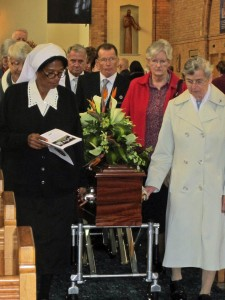 Walking with Bernadette's coffin